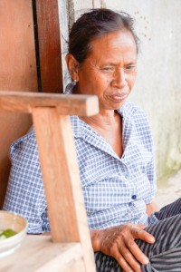 Reflective, as Ketut talks about work in the village